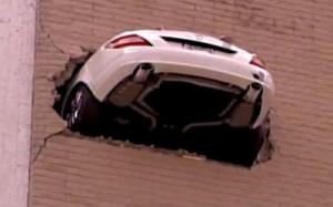 Ralph Huson's Mercedes dangling 7 stories outside a parking garage!!!