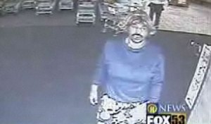 Dennis Hawkins the 'Fake Breasts,Blond Wig, Clown-Pants' bandit!!!