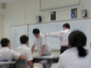 A Teacher Whipping A Student In Front of The Class.
