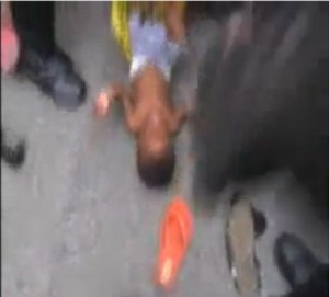 African Baby being Dragged Through The Streets By His Feet,Brutalized by The French Police