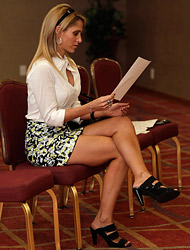 Ines Sainz wore a conservative sexy mini-skirt and blouse at today's press conference.