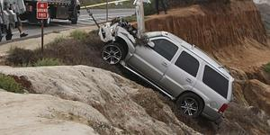 Seau's Escalade SUV went airborne over the steep embankment...
