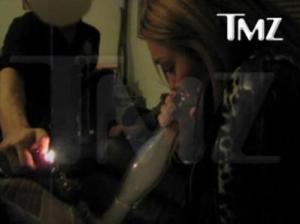Miley Cyrus taking a bong load of Salvia (Photo TMZ.com)