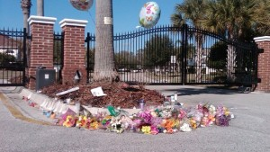 A memorial erected at the crime scene gates