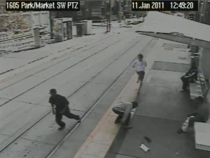 The victim (top of photo) runs away while the muggers snatch up and run with the loot.