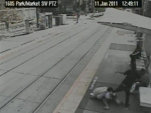 Two robbers in San Diego attack their  victim while people waiting for the trolley watch
