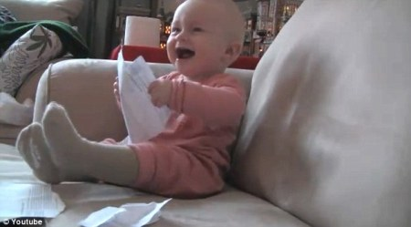 10-month old Micah Mcarthur laughs hysterically...