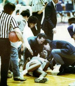 Hank Gathers lies dead on the court as his mother and coaches surround him (1990)
