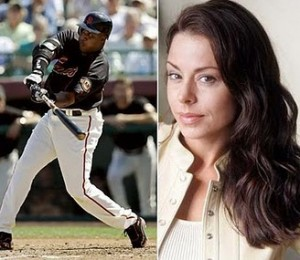 Kimberly Bell And Barry Bonds swinging the only full size bat he can grab...