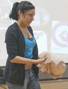 Gaby exposes her tummy padding