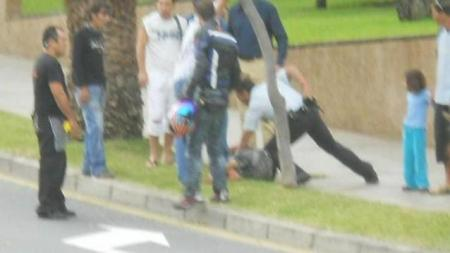 On-lookers Rugby tackle assailant