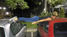Girl Planking  spread out on cars....