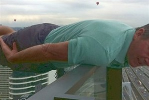 Sam Newman 'planking' off the balcony of a 40 story building in Queensland,Australia