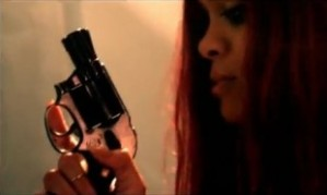 Gun toting Rhi Rhi